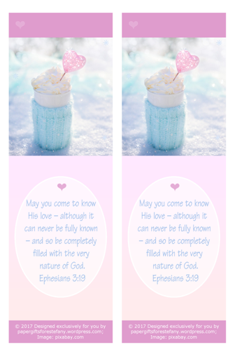 FREE pink bookmark with Bible verse from Ephesians 3:19; perfect to make you feel warm and cosy on a snowy day, this delicious cup of hot chocolate or coffee is wrapped in a soft aqua woollen jumper and set among the sparkling snow, filled with whipped cream and embellished with a pink heart; free printable