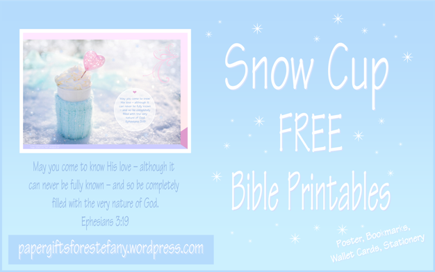 FREE printables with Bible verse from Ephesians 3:19; perfect to make you feel warm and cosy on a snowy day, this delicious cup of hot chocolate or coffee is wrapped in a soft aqua woollen jumper and set among the sparkling snow, filled with whipped cream and embellished with a pink heart; free printable